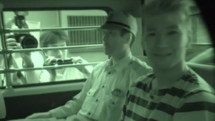 Japan stabbing suspect captured smiling as he heads to see prosecutors