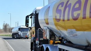 Petrol Tankers come and go from Stanlow Oil refinery, Ellesmere port, Cheshire.