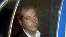 John Hinckley Jr arriving at a court in Washington in 2003