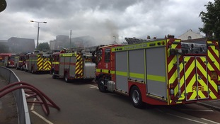 Exeter fire could take 'all night' to dampen down say emergency services