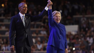 Obama passes the baton to Clinton in rousing speech