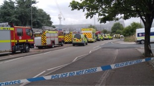 Crews remain at the scene of fire in Exeter