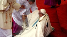 Pope Francis takes a tumble at start of Mass in Poland