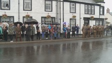 Mourners line the high street to pay their final respects