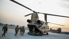 US personnel board a Chinook helicopter in the Nangarhar province of Afghanistan in 2014