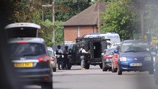 Three arrested after armed police swoop on house