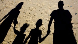 shadows of family on beach