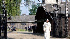 Pope meets Auschwitz survivors during Poland visit