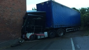 A41 remains closed in both directions after lorry crashes into a house