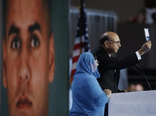 An image of the Khans' fallen son Humayun was projected behind them while they stood at the podium.