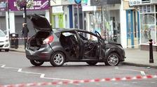 Robbers torch car after ram raid at high street bank