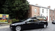 The hearse carrying the coffin of Dave Hopper, the secretary for the Durham Miners' Association, arrives at Miners' Hall in Durham for his funeral service