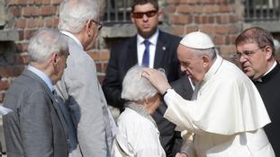 Pope meets Auschwitz survivors during Poland visit