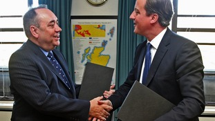 Scottish First Minister Alex Salmond shakes hands with Prime Minister David Cameron