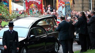 The hearse carrying the coffin of Dave Hopper.
