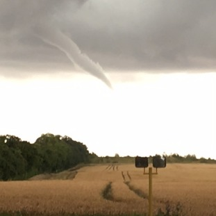 A funnel cloud forms near Duxford in Cambridgeshire on Friday afternoon.