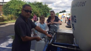 Residents fill up containers after Yorkshire Water deliver 100,000 litres of water.