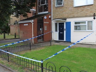 Police have sealed off a house in Gloucester