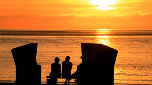 Holidaymakers in sunset