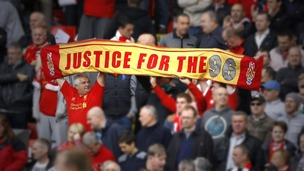 Fans hold a 'Justice for the 96' banner