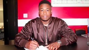 MK Dons have signed midfielder Chuks Aneke