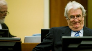 Former Bosnian Serb leader Karadzic sits in the courtroom on the first day of his defence