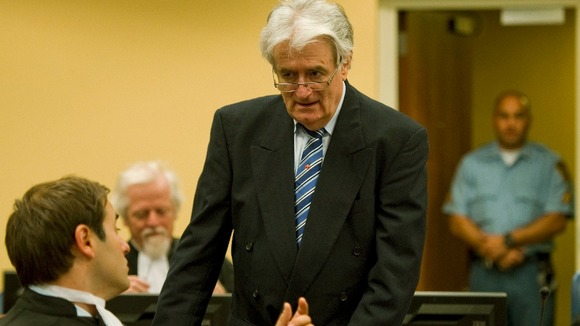 Karadzic talks to member of his legal team in court