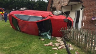 The car smashed into the side of the bungalow
