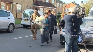 Dr Purnami De Silva arrives to lay flowers on behalf of staff at Princess Alexandra Hospital, Harlow