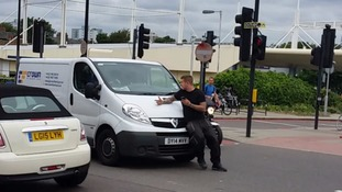 'Road rage' van shunts pedestrian shouting 'go on, run me over' along road