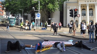 People have been lying on the tracks outside the Royal Centre Tram stop in Nottingham.
