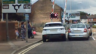 Dashcam footage shows car jumping warning lights to drive through Lowestoft crossing