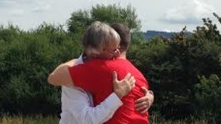 Hug for the hero doctor who saved a man impaled on a fence