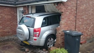 Extraordinary pictures show car smashed through a window