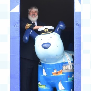 DFDS Captain Niels Vestergaard welcomes Skipper the Snowdog on board Princess Seaways following his trip along the Tyne