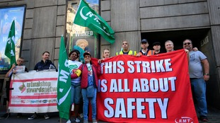 RMT union members strike outside Victoria Station in London.