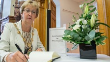 Lord Mayor of Londonderry Hilary McClintock signs book of condolence for Edward Daly.