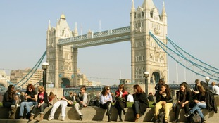 Office workers near Tower Bridge, in central London.
