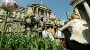 City workers enjoy the lunchtime sunshine outside the Bank of England, London.