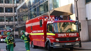 The fire brigade attend the scene as around 1,500 people were forced to leave the Hilton in Park Lane, London, due to a fire in a kitchen.