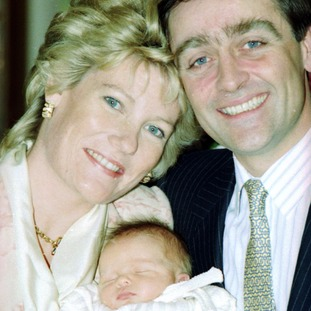 The Duke and Duchess of Westminster with their heir to his estate in 1991.