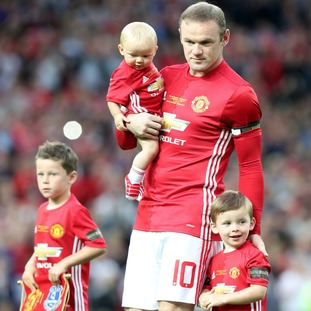 Rooney with his three sons