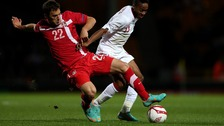 England's Raheem Sterling battles for the ball with Serbia's Filip Malbasic in the first leg last week