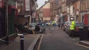 The car crashed into a shop last night.