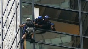 Climber scales Trump Tower - Donald Trump's political headquarters - for three hours in meeting bid