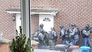 Watch moment cops with machine guns raid wrong house