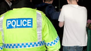 Police officers in dawn raids in North Manchester