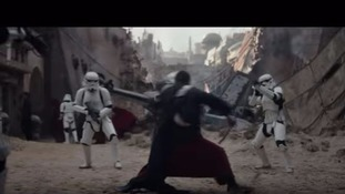 Stormtroopers face a rebel in a scene featured in the trailer
