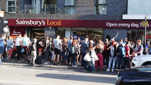 Scores hold mass gay 'kiss-in' at Sainsbury's after same-sex couple told off by security