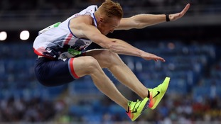 Greg Rutherford competes in the men's Long Jump final.
